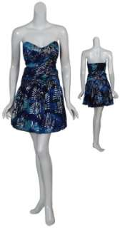 Cute strapless chiffon print cocktail dress has ruched bodice and full