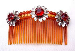 COLLECTION OF THREE GLITZY DYNASTY STYLE HAIR COMBS EMBELLISHED WITH