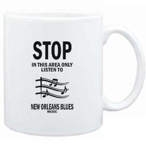 Mug White  STOP   In this area only listen to New Orleans