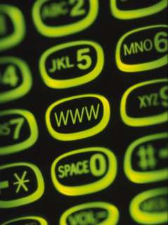 Glowing Green Cell Phone Keypad with Www Web Sign on Key Photographic