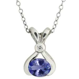 0.79 Ct Oval Blue Tanzanite and White Topaz 14k White Gold